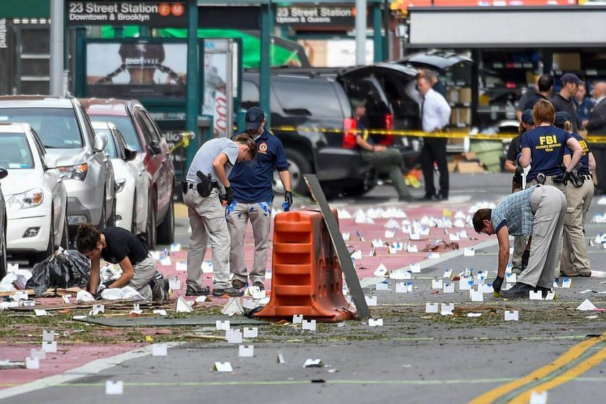 FBI officials collect evidence from the site of the explosion in New York on Sept 18. Investigators are searching for links between three attacks across the United States over the weekend.