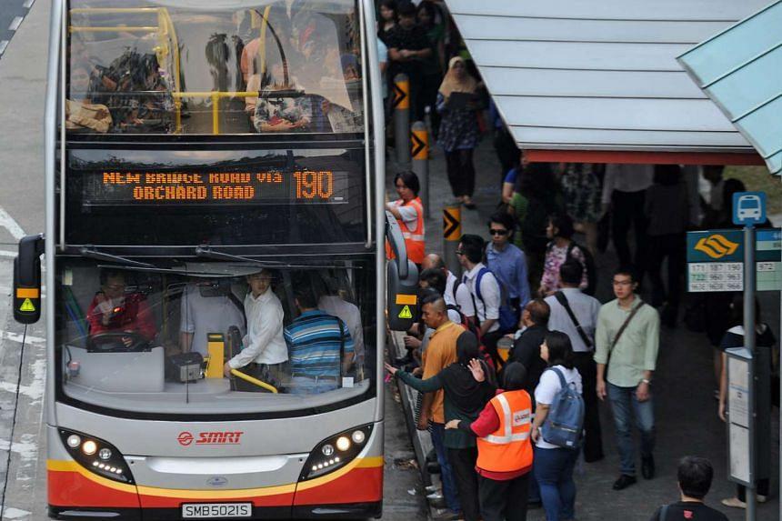 Commuters at the bus stop before the Kranji Expressway at Bukit Panjang.