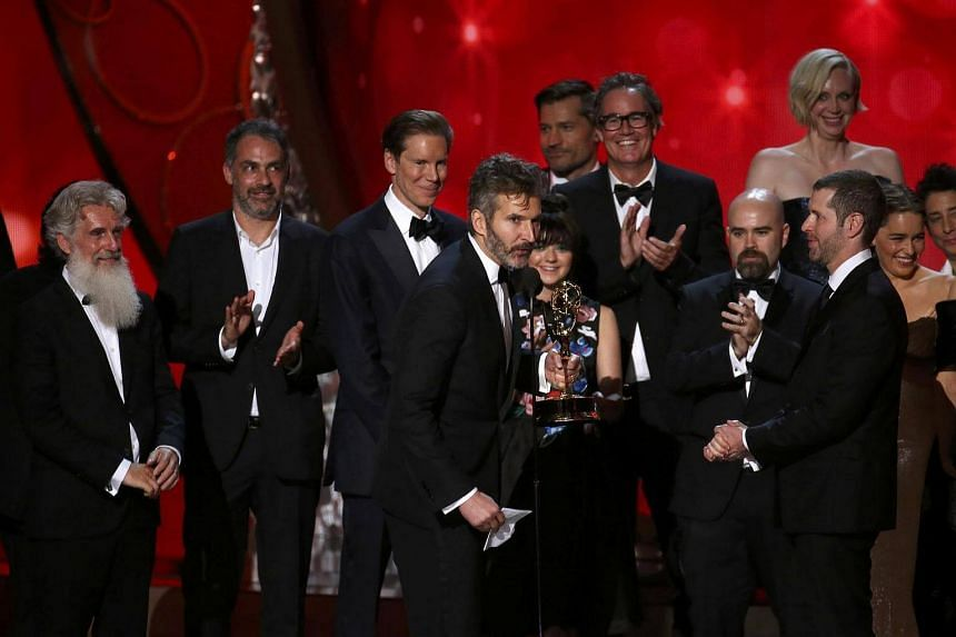 Game of Thrones Executive Producers David Benioff and D.B. Weiss accept the award for Outstanding Drama Series at the 68th Primetime Emmy Awards in Los Angeles.