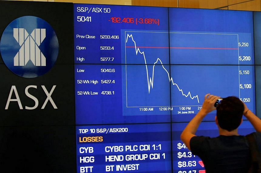 A visitor to Australia's Stock Exchange in Sydney takes a picture of the S&P/ASX 50 Index on June 24, 2016.