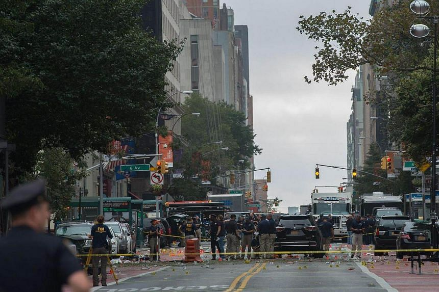 Members of the NYPD, FBI, ATF and other agencies at the scene of an explosion on West 23rd Street, New York, on Sept 18, 2016.