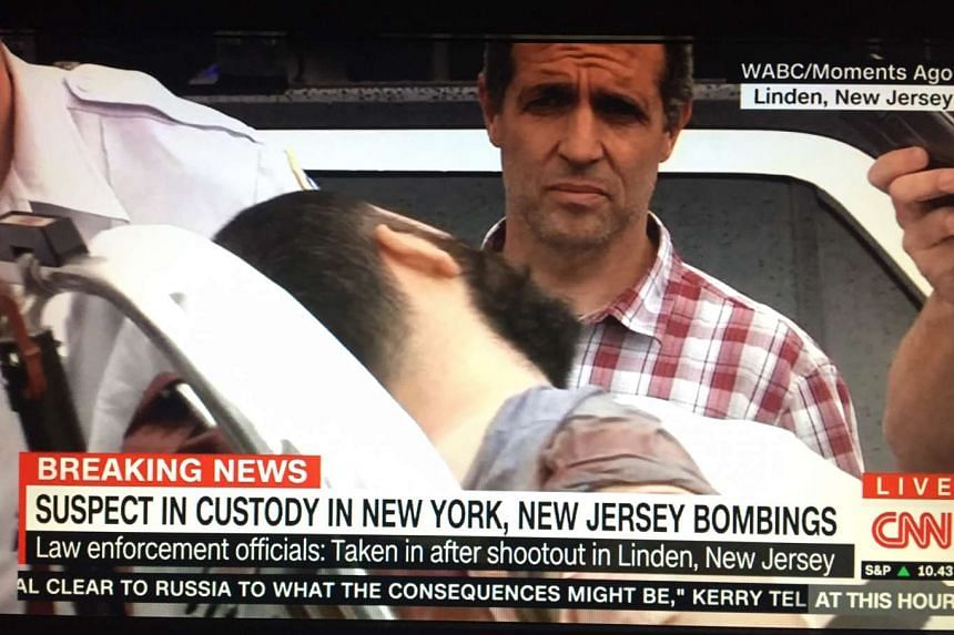 Screengrab of Ahmad Khan Rahami from CNN showing him being wheeled into an ambulance after a shootout with police in Linden, New Jersey.