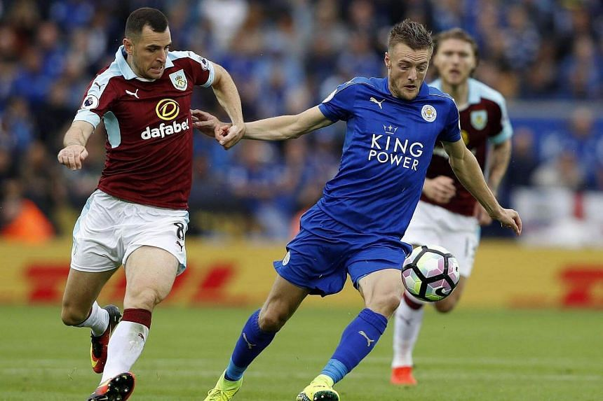 Leicester City's English striker Jamie Vardy vies for the ball against Burnley's English midfielder Dean Marney during the English Premier League football match between Leicester City and Burnley on Sept 17, 2016.