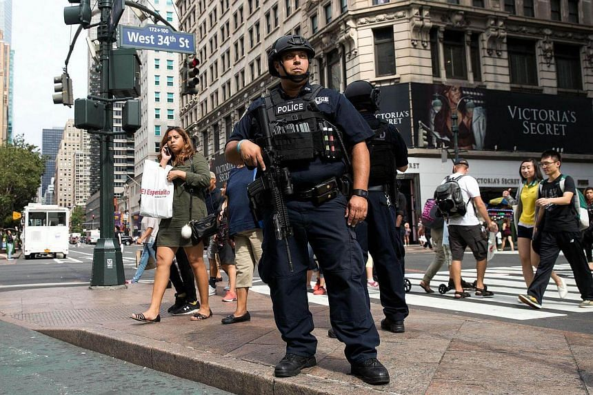 A member of the New York City Police Department stands guard in Herald Square, on Sept 18, 2016 in New York City.