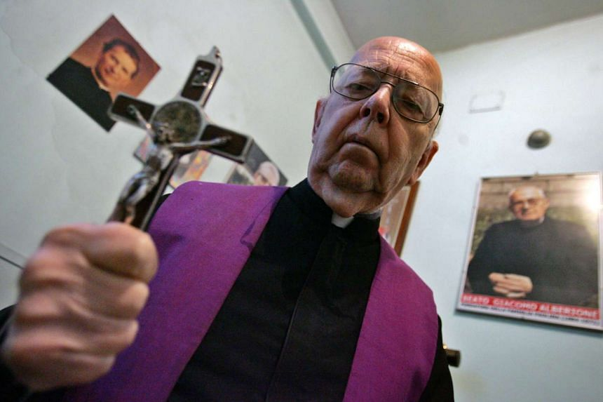 Former exorcists Don Gabriele Amorth, president of honour of the Association of Exorcists, poses in Rome in 2005.