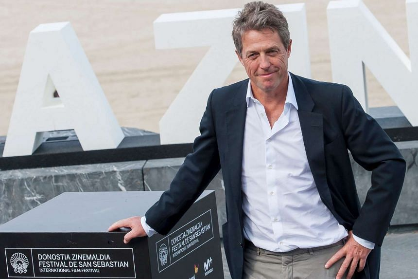 Hugh Grant poses after the screening of his film Florence Foster Jenkins during the 64th San Sebastian Film Festival in Spain.