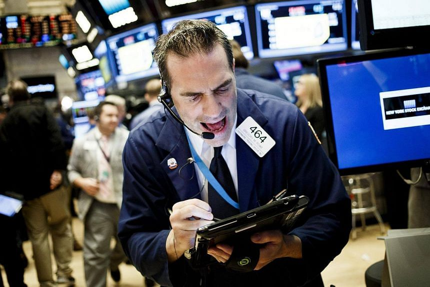 Traders work on the floor at the Opening Bell of the New York Stock Exchange in New York, US, on Sept 16, 2016.