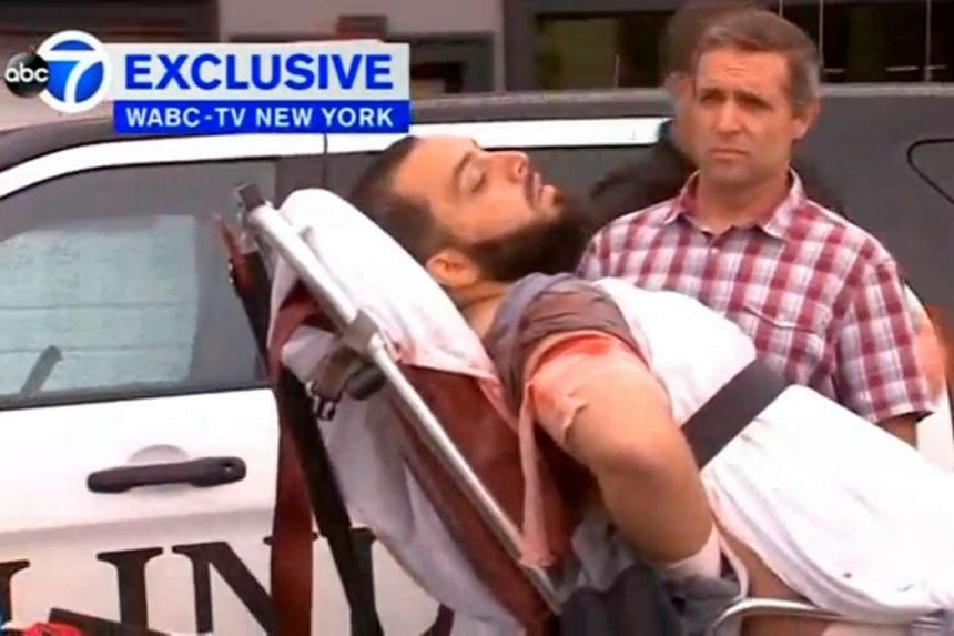 A man believed to be New York bombing suspect Ahmad Khan Rahami being loaded into an ambulance after a shoot-out with police in Linden, New Jersey, on Sept 19, 2016.