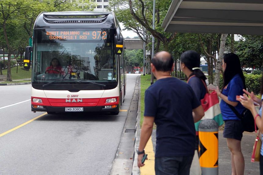 Commuters wait to board bus service 972 at Jelapang Road