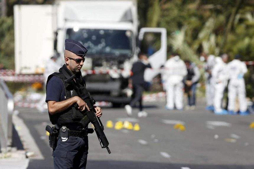 French police secure the Promenade des Anglais in Nice on July 15, 2016, a day after a heavy truck ran into a holiday crowd at high speed and killed scores.
