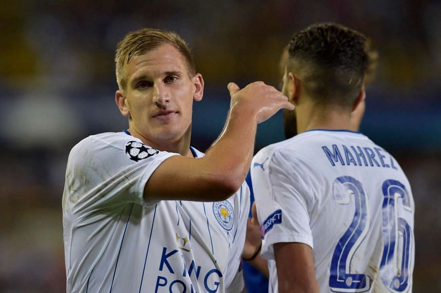 Leicester City's Riyad Mahrez is congratulated by Marc Albrighton as he walks off to be substituted in their UEFA Champions League group stage match against Club Brugge.