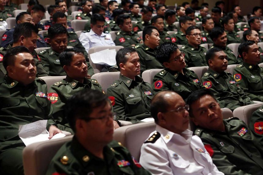 Military representatives attend the International Day of Democracy 2016 ceremony held at Parliament in Naypyitaw, on Sept 15, 2016.