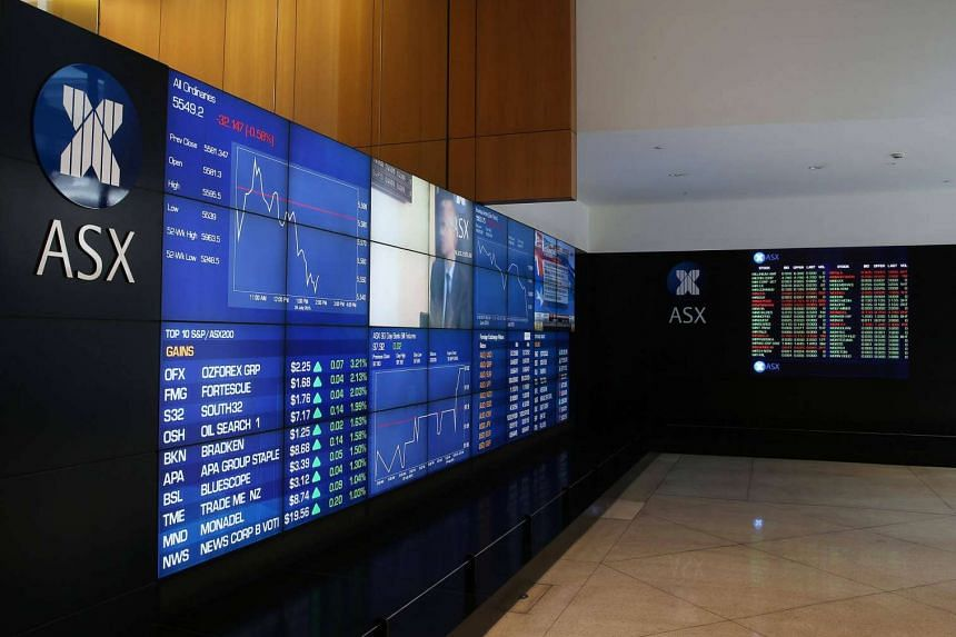 Stock information is displayed on an electronic board inside the Australian Securities Exchange.