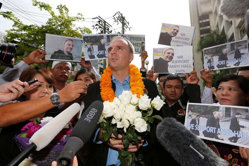 British rights activist Andy Hall speaks to reporters as he arrives at the Bangkok South Criminal Court to hear the verdict on charges of defamation and computer crimes.