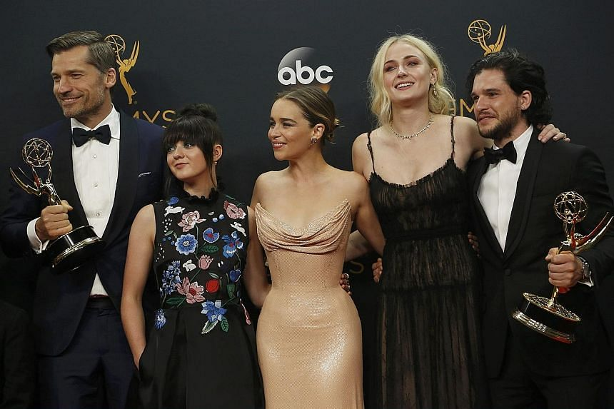 From left: Nikolaj Coster-Waldau, Maisie Williams, Emilia Clarke, Sophie Turner and Kit Harington of HBO's Game Of Thrones, which won Outstanding Drama Series at the 68th Primetime Emmy Awards.
