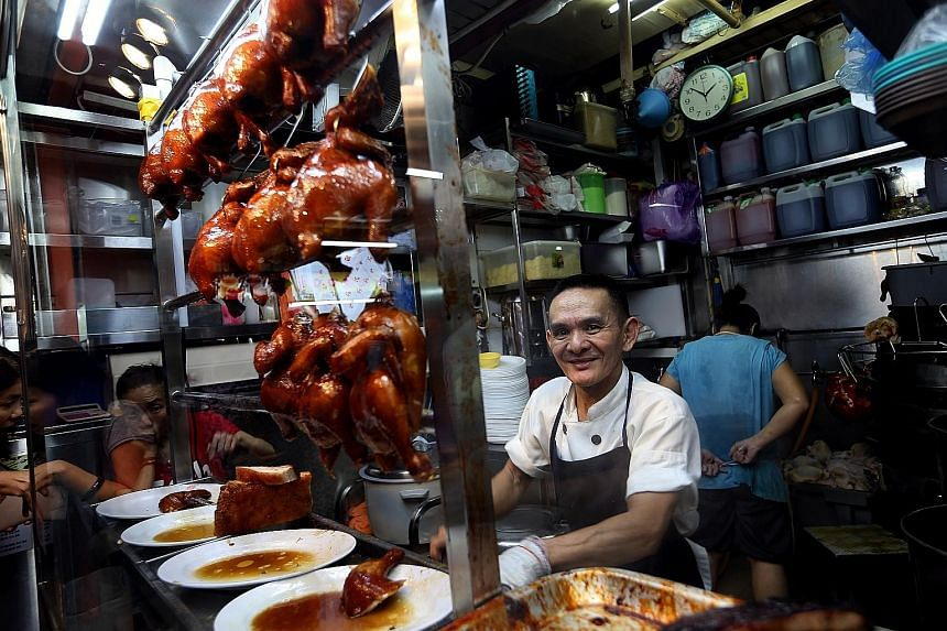 Liao Fan Hong Kong Soya Sauce Chicken Rice & Noodle stall owner Chan Hon Meng (left) sells about 160 chickens daily.