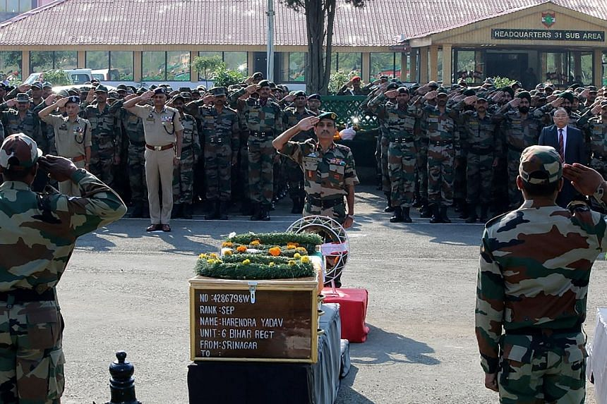 A wreath-laying ceremony being held in Srinagar yesterday to honour the 18 soldiers killed in Sunday's attack on the Indian Army base in Uri. India has blamed Pakistan for the commando-style attack by four heavily armed militants, while Pakistan has