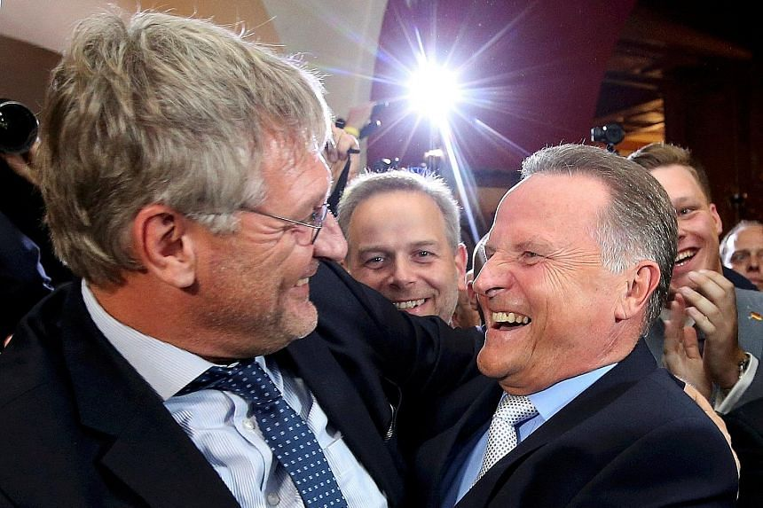 AfD's co-leader Joerg Meuthen (left) and the party's top Berlin candidate, Mr Georg Pazderski, smiling after the first exit polls of the Berlin election in Germany on Sunday. The anti-Islam party won fresh support.