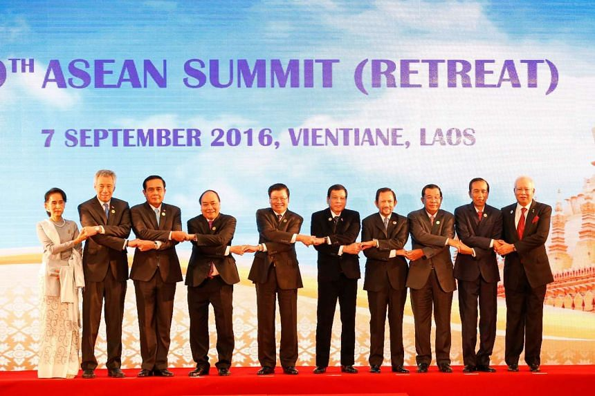 Leaders of  Asean nations pose for photo during a summit in Vientiane, Laos on Sept 7, 2016. -