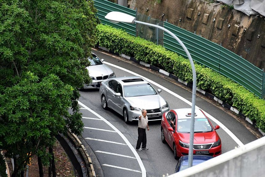 A motorist reacting to the stalled traffic on the flyover.