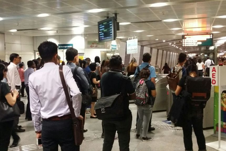 Commuters blocked at the gantries from entering the Circle Line platform at Bishan.