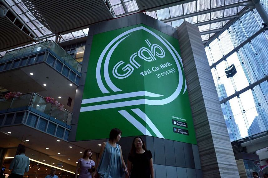A Grab taxi banner on display in Change Alley at Raffles Place in the Central Business District on Feb 24, 2016.