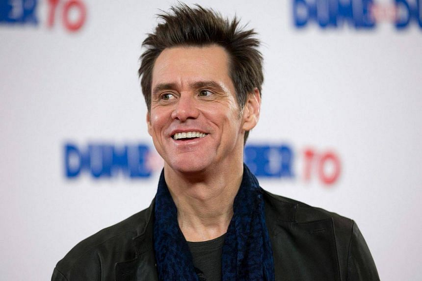 Jim Carrey at a premiere for film Dumb and Dumber To on Nov 20, 2014. He has been hit with a lawsuit over his girlfriend's death.
