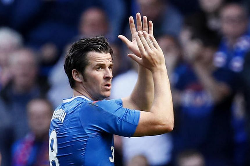 Joey Barton applauds fans as he is substituted in Ibrox Stadium during the Rangers VS Burnley pre-season friendly on July 30, 2016.