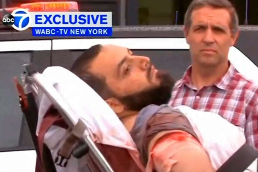 A conscious man believed to be New York bombing suspect Ahmad Khan Rahami being loaded into an ambulance after a shoot-out with police in Linden on Sept 19, 2016.
