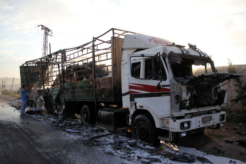 A damaged aid truck is seen on the outskirts of Aleppo after the convoy it was in was hit by an airstrike, on Sept 20, 2016.