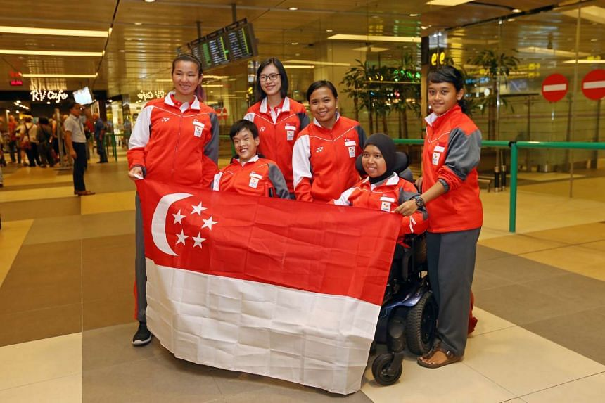 Boccia players (front right) Nurulasyiqah Mohammad Taha and (front left) Toh Sze Ning, Chew Zi Qun (Sze Ning's sports assistant), Tess Tan (coach), Nur Azizah (caregiver), Sya Taha (Nurul's sister and sports assistant), at Changi Airport Terminal 1,