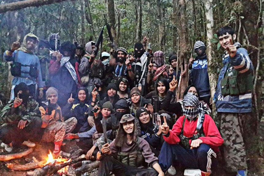 Members of the East Indonesia Mujahideen (MIT) terrorist group at their hiding place in the forests of Poso in Central Sulawesi.