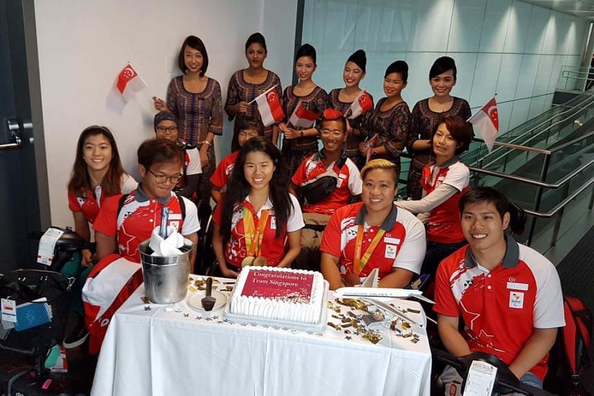 Team Singapore's Paralympians during a stopover in Barcelona.