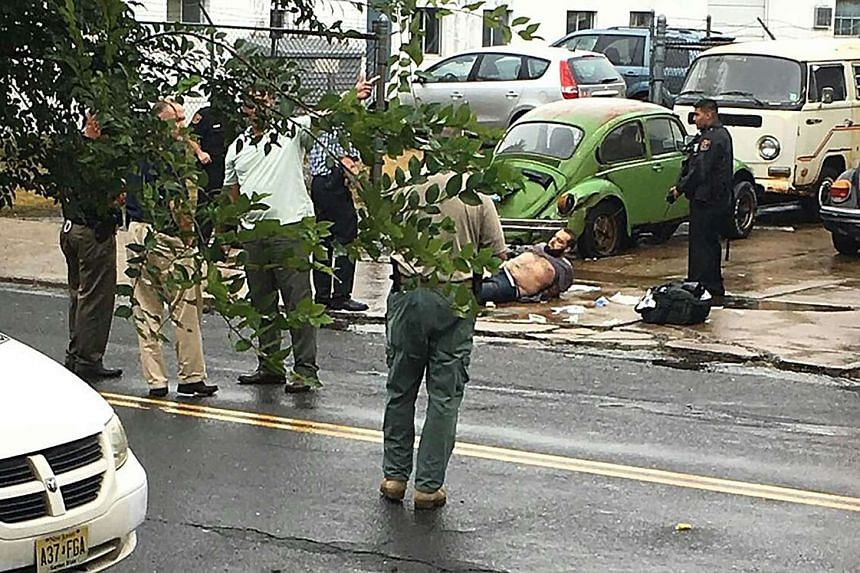 Police surround New York bombing suspect after shoot-out in Linden, New Jersey on Monday (Sept 19).