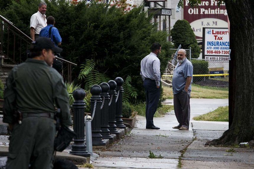 FBI investigators gather evidence at the family's business, First American Fried Chicken, in Elizabeth, New Jersey.