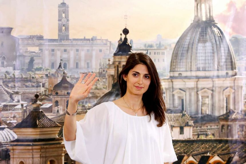 Rome's mayor Virginia Raggi gestures during a news conference in Rome, Italy on June 20, 2016.
