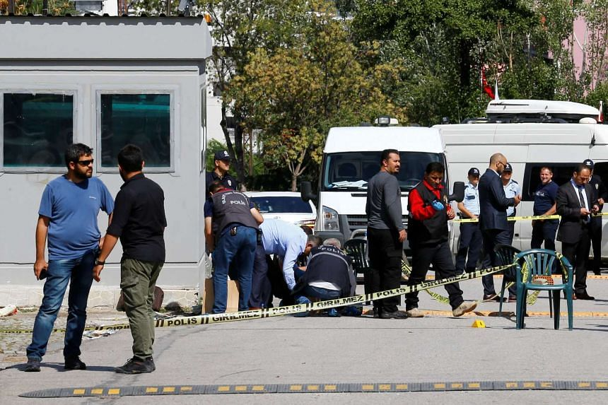 Forensic investigators examine the area in front of the Israeli embassy in Ankara, Turkey, on Sept 21, 2016.