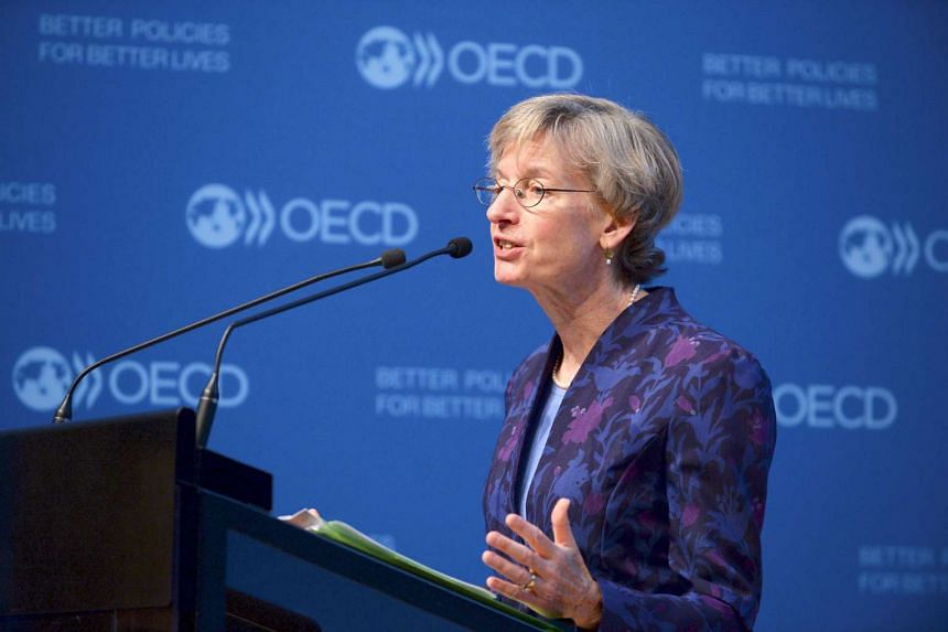 OECD chief economist Catherine Mann presents the OECD interim economic outlook at the OECD headquarters in Paris on Sept 21, 2016.