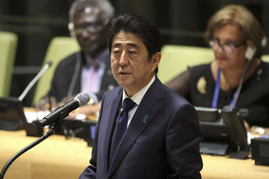 Japanese Prime Minister Shinzo Abe speaks at a high-level meeting on refugees and migrants at the UN General Assembly in Manhattan on Sept 19, 2016.