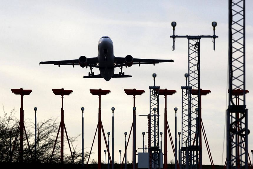 An aircraft approaches the runway to land at Luton airport.