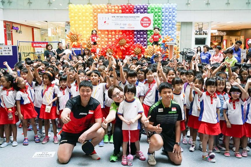 The Republic's Olympic paddler Gao Ning (left) and STTA-PCF graduate Andy Wong at the STTA-PCF Table Tennis Carnival on Tuesday at One KM mall.