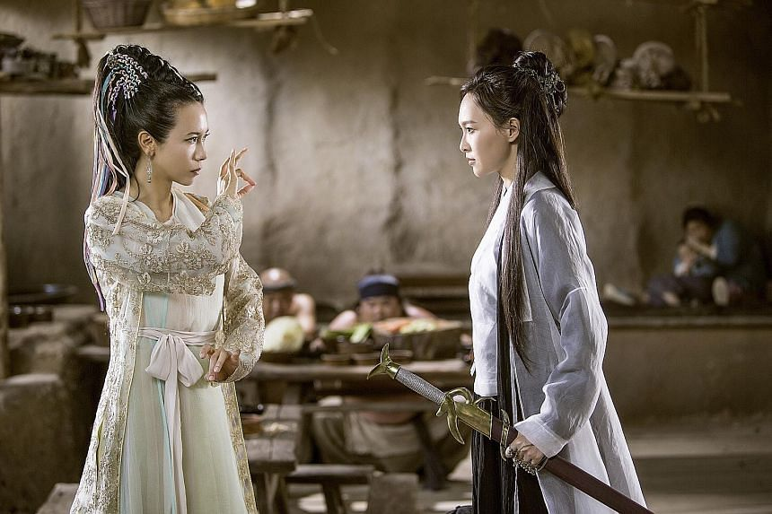 Karen Mok (far left) as the demon, Bak Jing-jing, and Tiffany Tang as fairy Zixia in A Chinese Odyssey Part Three.