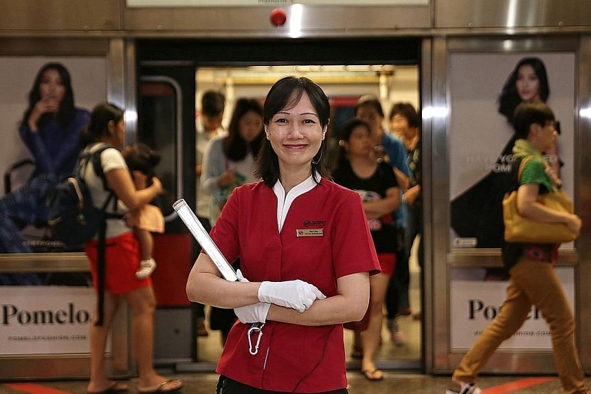 SMRT service ambassador Lim Yen Ling said training from the Forget Us Not initiative has enabled her to better identify and assist people with dementia in the midst of a chaotic peak-hour crowd.