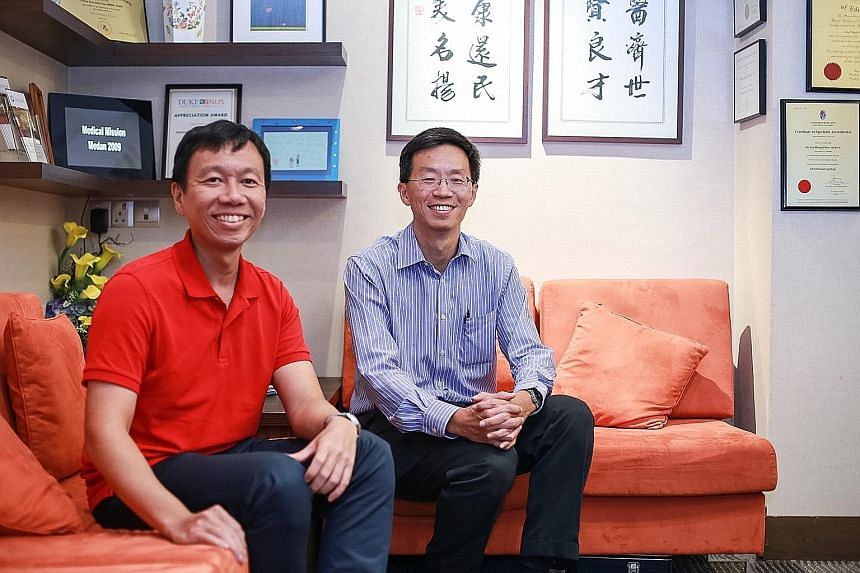Nose cancer survivor Wongso Shianturi Wijaya (far left) and surgeon Andrew Loy. Dr Loy found a 2cm tumour deep inside Mr Wongso's nose after the latter complained of persistent nosebleeds following a traffic accident.