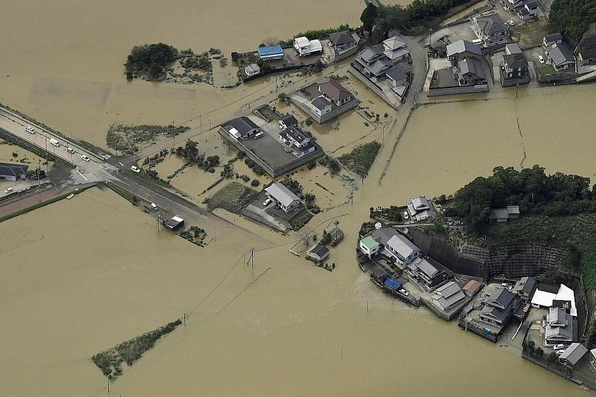 An aerial view of the damage from floods due to heavy rain brought by Typhoon Malakas in the south-western city of Nobeoka in Japan's Miyazaki prefecture yesterday. At least 36 people were injured and one went missing as the powerful typhoon, packing
