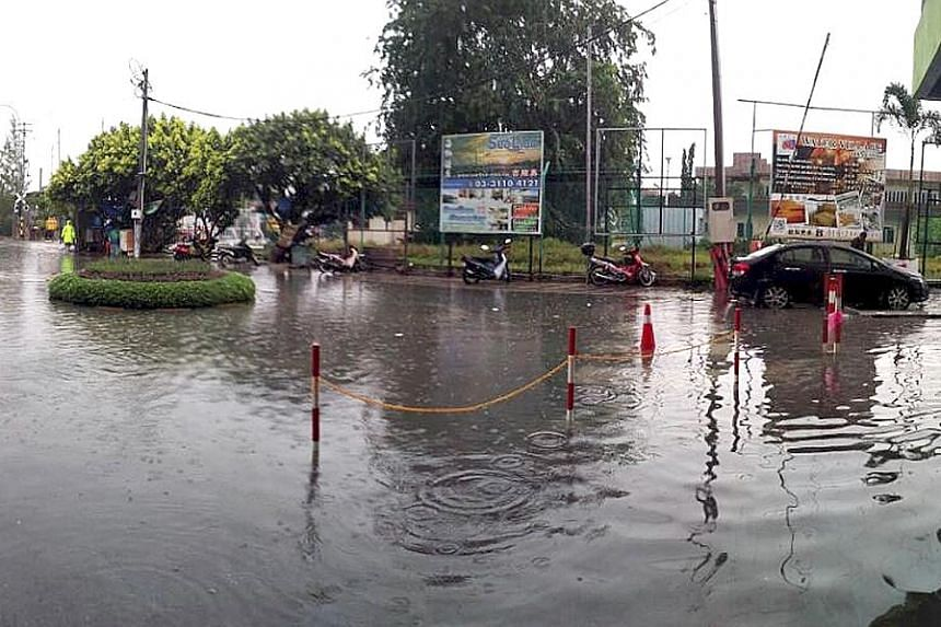 Flooding in Port Klang yesterday. Waves as high as 2.7m and strong winds contributed to the problem, according to an official.