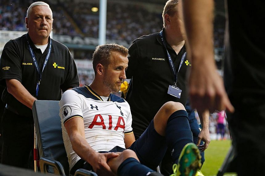 Tottenham striker Harry Kane being wheeled away on a stretcher after twisting his ankle against Sunderland in their Premier League game on Sunday. The likelihood is that he has grade two ligament damage.
