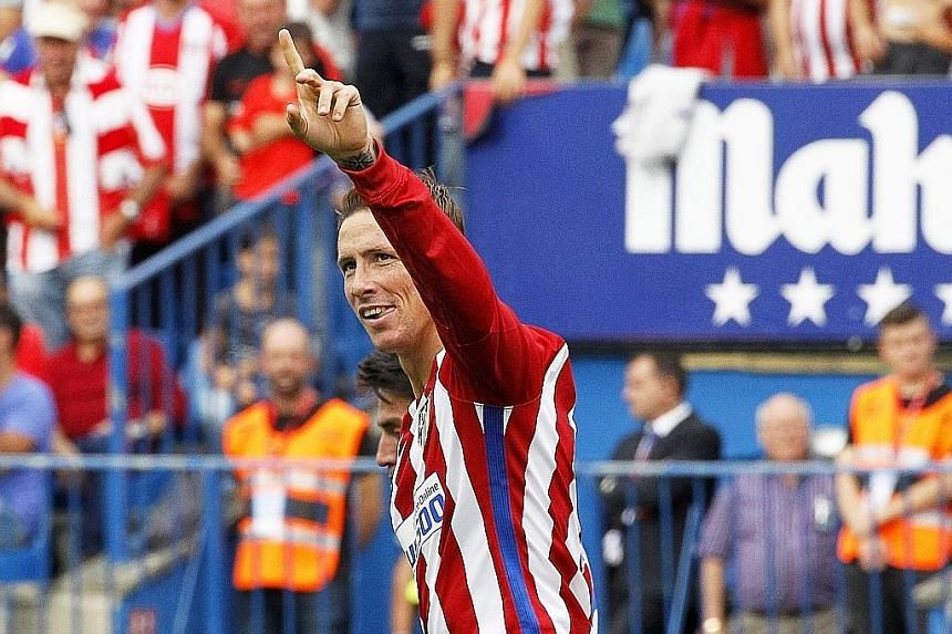 Fernando Torres celebrating one of his two goals in Atletico Madrid's 5-0 walloping of Sporting Gijon. Atletico play Barcelona.