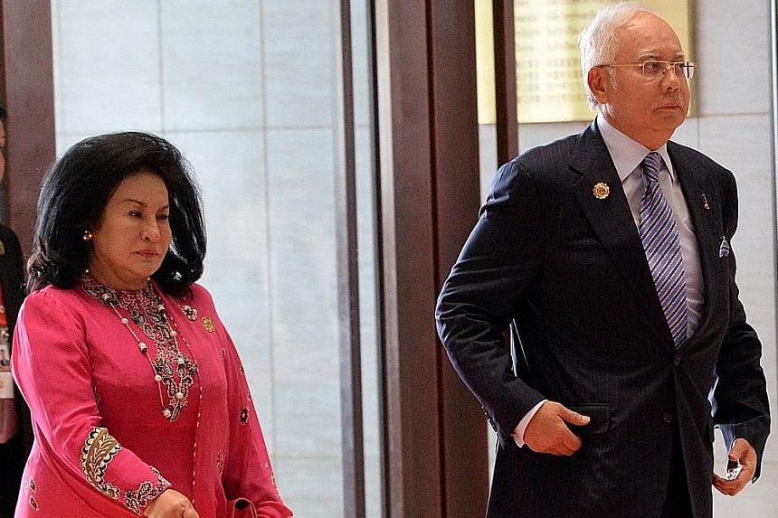 Mr Najib and his wife Rosmah Mansor, who was to receive an award for her work as patron of government body Permata. The awarding body later said it was deferring the award, a move Mr Najib's office said was due to a smear campaign by foreign papers c