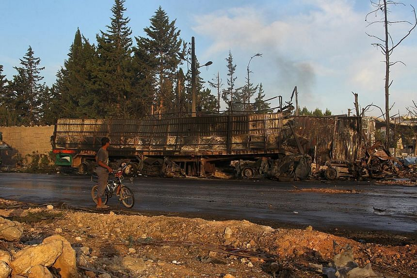 An aid truck destroyed in Monday night's strike, which hit at least 18 of 31 vehicles delivering aid under a joint UN, Red Cross and Red Crescent operation for the town of Orum al-Kubra in Aleppo province. Several civilians were killed, including a s